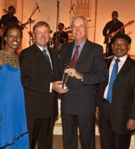 Dave Herbert, center, CEO of Great Safaris, accepting the 2010 Lifetime Achievement Ubuntu Award from the Hon M. van Schalkwyk, the South Africa Minister of Tourism.
