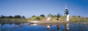 Botswana safaris riding in a mokoro in the Okavango Delta