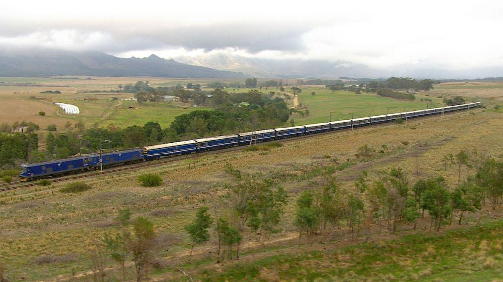 TheBlue Train traverses the South African countryside